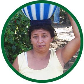 Woman carrying water jug on head