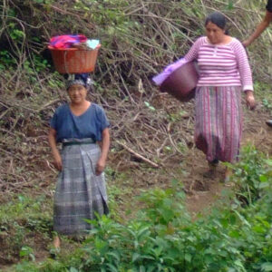 Woman carrying baskets on head